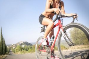 C:\Users\USER\Downloads\female-cyclist-riding-bicycle-along-mountain-road-in-summer-3771806.jpg